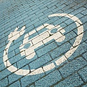 The Netherlands, Overijssel, Symbol of an electric car charging station on the ground - HAWF000440
