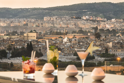 Morocco, Fes, view to the city from the roof terrace of a hotel by sunset - KM001366