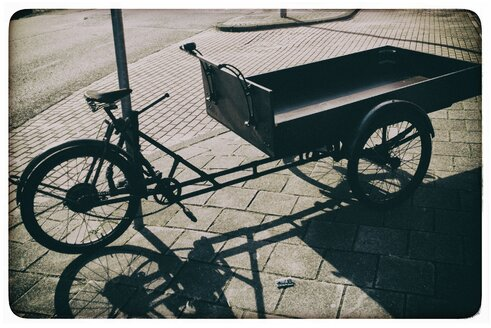 The Netherlands, North-Holland, Amsterdam, Cargo tricycle on pavement - HAW000451