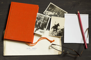 Family history, Genealogical research, Old pictures from Second World War, Air Mail, Red book,  Notepad with coloured pencil and reading glasses - CM000159