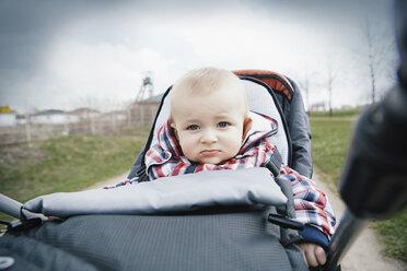 Germany, Oberhausen, Blond baby boy sitting in pram - GD000395