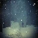 Man walking in winter twilight at snowfall, digital alteration - DWI000160