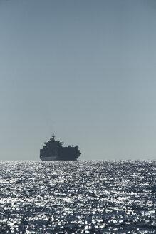 Spain, Andalusia, Tarifa, Cargo ship - KBF000143
