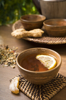 Ginger lemon tea in a tea bowl, candied and fresh ginger - CSTF000388