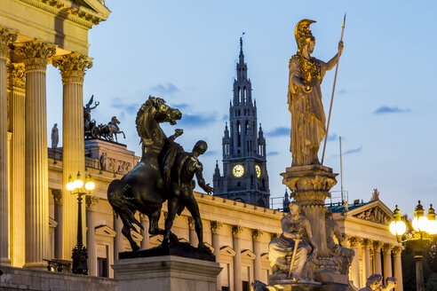 Austria, Vienna, view to parliament building, town hall tower and statue of goddess Pallas Athene by twilight - EJWF000531