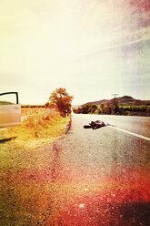 Spain, man lying on a street - MS004156
