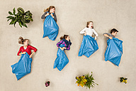 Children doing sack race in litter bags - BAEF000724