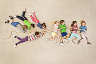 Children playing tug of war - BAEF000806