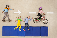 Children cycling, skateboarding and running in the street - BAEF000878
