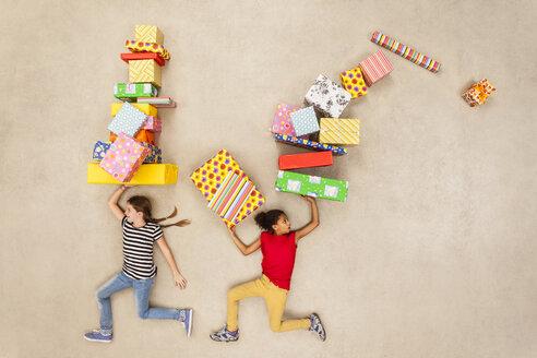 Children with heaps of birthday presents - BAEF000992