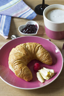 Croissant with butter on plate, jam and Cafe au lait - YFF000218