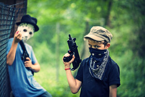Two masked boys playing with toy weapons - PA000849