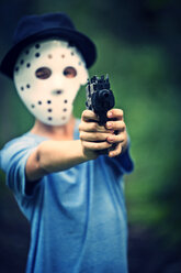 Masked boy aiming with toy gun - PA000851