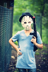 Masked boy with toy weapon - PA000853