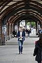 Germany, Berlin, Businessman walking in the city - FKF000634