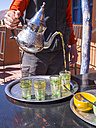 Morocco, Marrakesh-Tensift-El Haouz, Anammer, Man pouring tea in a tea glass - AM002757