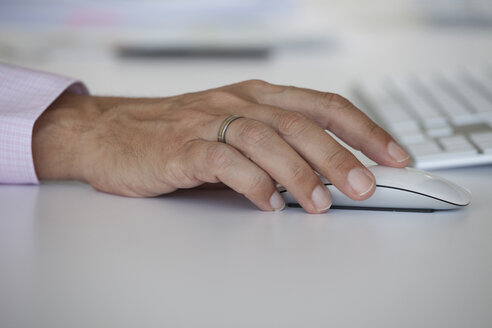 Man's hand on a computer mouse - RBF001875
