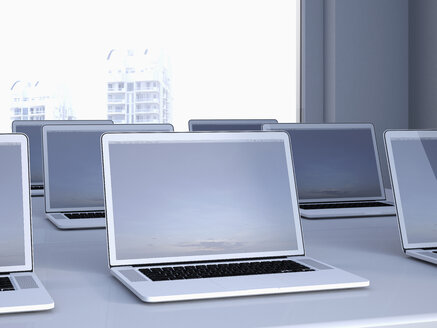 Opened laptops on a table in a n office, 3D Rendering - UWF000166