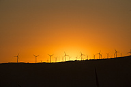 Spain, Andalusia, Tarifa, Wind farm at sunset - KBF000165