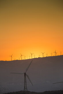 Spain, Andalusia, Tarifa, Wind farm at sunset - KBF000167