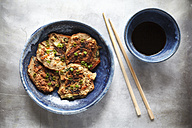 Japanese buckwheat pancakes with tofu and vegetable, chopsticks and bowl of soy sauce - EVGF000822
