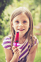 Portrait of little girl with popsicle in the garden - SARF000786