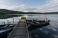 Germany, Rhineland-Palatinate, Laach Lake, Man sitting in a rowing boat - PAF000908