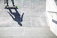 Shadow of a skate boarder on pavement - ZEF000768