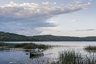 Germany, Rhineland-Palatinate, Laacher See, father and son in rowing boat - PAF000913
