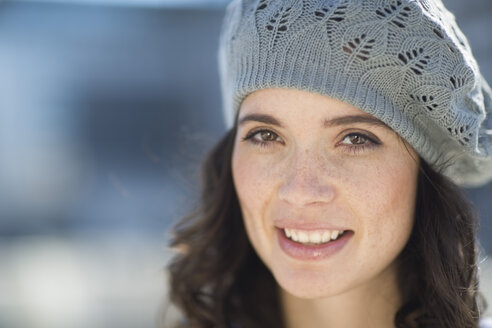 Portrait of smiling woman with wool cap - ZEF000785