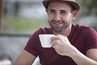 Portrait of smiling man having a coffee break - ZEF000326