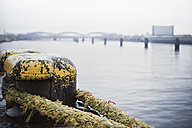Germany, Hamburg, Old Warehouse District, Pollard with rope, old Elb brigdes in the background - ASCF000002