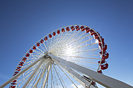 Ferris wheel against blue sky - FOF007141