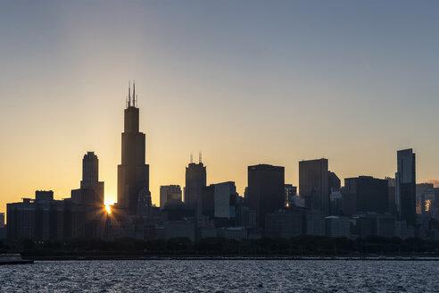 USA, Illinois, Chicago, Skyline, Willis Tower and Lake Michigan at sunset - FO007211