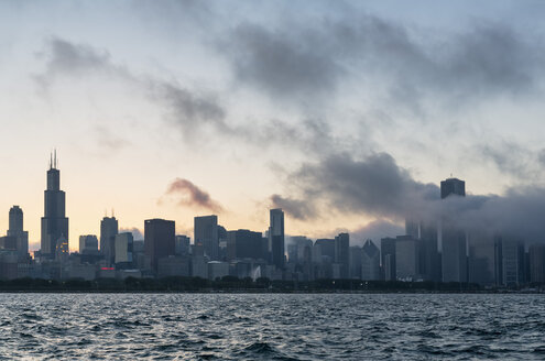 USA, Illinois, Chicago, Skyline, Willis Tower and Lake Michigan at sunset - FOF007228