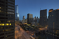USA, Illinois, Chicago, skyscrapers with Trump Tower and Chicago River at night - FOF007151