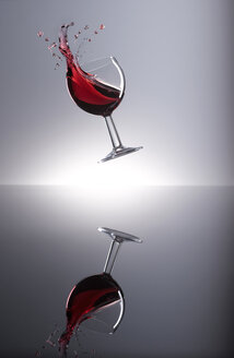 Red wine shaking in glass - KSWF001324