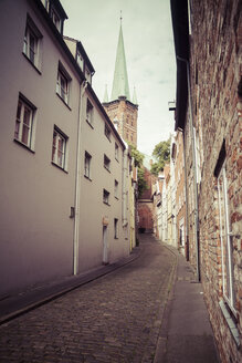 Germany, Schleswig-Holstein, Luebeck, old town, Alley Kleine Petersgrube, Tower of St. Peter's Church - KRPF001021