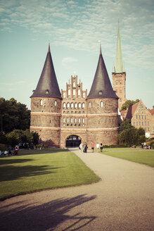 Germany, Schleswig-Holstein, Luebeck, Holsten Gate, Saint Peter's Church in the background - KRPF001022