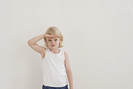 Portrait of little boy shielding his eyes with his hand - MJF001328