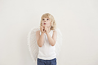 Portrait of little boy with angle wings looking up - MJF001340