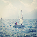 Italy, Veneto, Children sailing on lake Garda - LVF001844