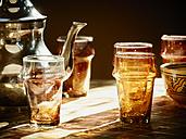 Morocco, Casablanca, tea pot and tea glasses in a teahouse - KMF001476