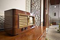 Morocco, Fes, old radio on a chest of drawers at Hotel Riad Fes - KMF001482