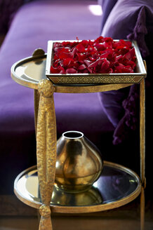 Morocco, Fes, tray of red rose petals in a suite of Hotel Riad Fes - KMF001431