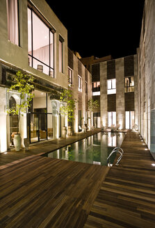 Morocco, Fes, Hotel Riad Fes, courtyard with swimming pool by night - KMF001449
