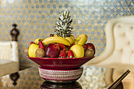 Morocco, Fes, Hotel Riad Fes, bowl with fruits in a hotel room - KMF001469