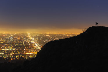 USA, California, Los Angeles, Cityscape and photographer on a mountain - FOF007001