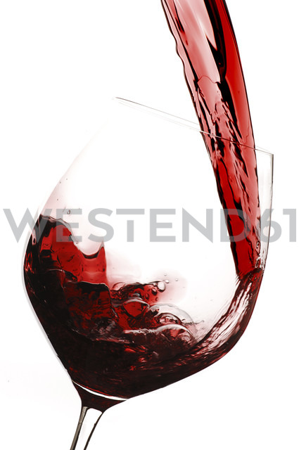 Red wine being poured into wine glass - IPF000155