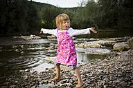 Little girl dancing at riverside - LVF001790